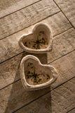 Dos corazones en la tabla Fotos de archivo