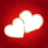 Dos corazones en un fondo rojo Imagen de archivo