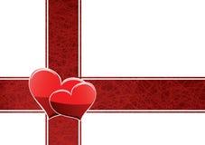 Dos corazones en una cinta roja Imágenes de archivo libres de regalías