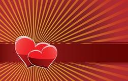 Dos corazones en una cinta roja Imagenes de archivo