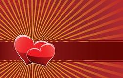 Dos corazones en una cinta roja Foto de archivo