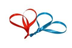 Dos corazones hechos de cintas Fotos de archivo