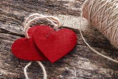 Dos corazones ligados juntos Imágenes de archivo libres de regalías