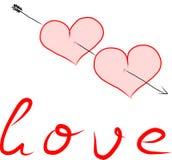Dos corazones perforados por una flecha Imagen de archivo libre de regalías