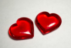 Dos corazones plásticos Fotografía de archivo libre de regalías