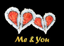 Dos corazones que forman a partir de cuatro pedazos de sushi Foto de archivo libre de regalías