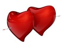Dos corazones rojos con la flecha Fotos de archivo