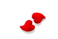 Dos corazones rojos en blanco Imagen de archivo