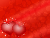 Dos corazones rojos en fondo rojo con las estrellas Fotografía de archivo