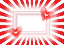 Dos corazones rojos en un marco hermoso y rayos Imagen de archivo libre de regalías