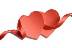 Dos corazones y cintas Fotografía de archivo