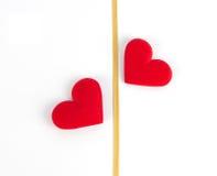 Dos corazones y cintas del oro Imagen de archivo libre de regalías