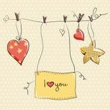 Dos corazones y estrellas en fondo amarillo Fotos de archivo libres de regalías