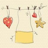 Dos corazones y estrellas en fondo amarillo Fotografía de archivo