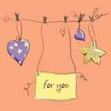 Dos corazones y estrellas en fondo rosado Fotografía de archivo libre de regalías
