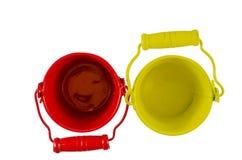 Dos cubos rojos y amarillos desde arriba Imagen de archivo