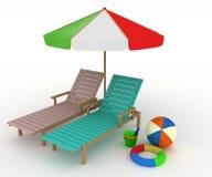 Dos deckchairs bajo un paraguas Imagen de archivo libre de regalías