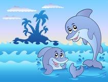 Dos delfínes que juegan en ondas Imagen de archivo libre de regalías
