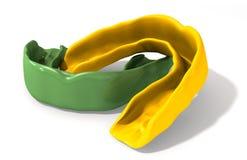 Verde del guardia de la goma y perspectiva del oro Imágenes de archivo libres de regalías