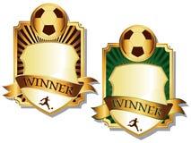 Dos emblemas de oro del fútbol Imagen de archivo libre de regalías