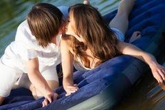 Dos en el colchón de la natación Imagen de archivo libre de regalías