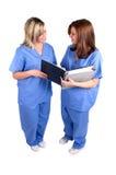 Dos enfermeras aisladas Imagen de archivo libre de regalías