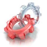 Dos engranajes de cristal de la rueda dentada en el fondo blanco Foto de archivo