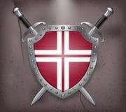 Dos espadas cruzadas que están detrás del escudo Imágenes de archivo libres de regalías