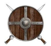 Dos espadas cruzadas y escudo de madera de vikingo aislados Fotos de archivo