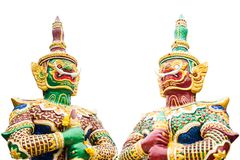 Dos estatuas gigantes guardan en el templo del budismo Foto de archivo libre de regalías