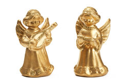 Dos estatuillas de oro del ángel de la Navidad foto de archivo
