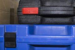 Dos estuches de plástico para las herramientas eléctricas Imagen de archivo libre de regalías