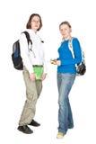 Dos estudiantes con el morral y el cuaderno. Fotos de archivo