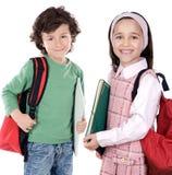Dos estudiantes de los niños Imágenes de archivo libres de regalías