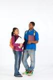 Dos estudiantes felices - vertical Imagen de archivo libre de regalías
