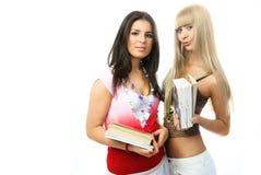 Dos estudiantes hermosos con los libros Imagen de archivo libre de regalías