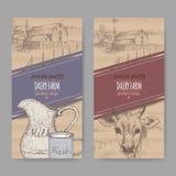 Dos etiquetas de la lechería con el cortijo, la vaca, la jarra de la leche del color y la taza libre illustration