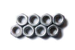Dos filas de las nueces del tornillo aisladas en el top del blanco abajo ven Foto de archivo libre de regalías