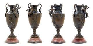 Dos floreros de bronce antiguos con la figura del ángel. Imágenes de archivo libres de regalías