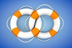 Dos flotadores blancos con la cuerda de la tapa Imágenes de archivo libres de regalías