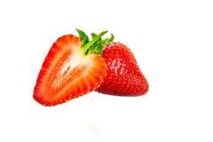 Dos fresas en el fondo blanco Imágenes de archivo libres de regalías