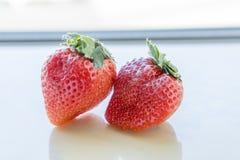 Dos fresas en el fondo blanco Foto de archivo libre de regalías