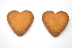 Dos galletas bajo la forma de corazones - símbolo del amor Fotografía de archivo