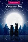 Dos gatos que sientan o una cerca que mira la luna Imagen de archivo libre de regalías