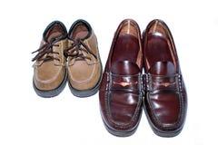 Dos generaciones de zapatos Fotos de archivo libres de regalías