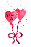 Dos globos bajo la forma de corazón atado con una cinta con la inscripción aman Fotos de archivo libres de regalías