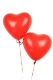 Dos globos rojos del corazón Fotos de archivo