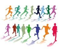 Dos grupos coloridos de corredores Foto de archivo libre de regalías