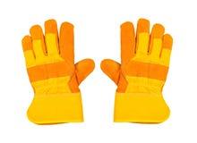 Dos guantes amarillos del trabajo, en el fondo blanco Foto de archivo