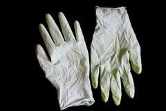 Dos guantes de goma arrugados Fotos de archivo libres de regalías